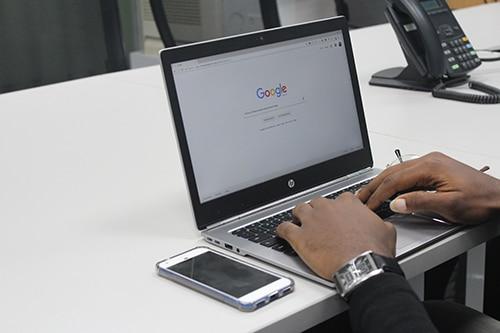 Man doing Google search.